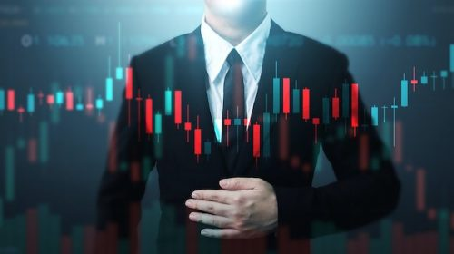 Double exposure businessman and candle line graph. Technical price candlestick chart graph and indicator stock online trading